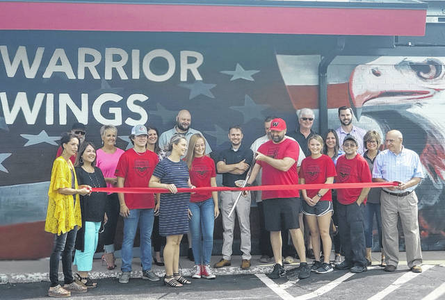 A ribbon cutting was held Friday for Warrior Wings, a veteran-owned and operated quick-service restaurant specializing in fresh chicken wings, tenders, and their special bird-dogs. Pictured are owners Brock and Alyona Nagel, along with employees and Wauseon Chamber of Commerce members. A part of each sale is used to help local veteran causes within the community. Warrior Wings is located at 850 N. Shoop Ave., Wauseon.