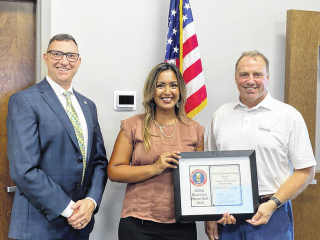 The Wauseon Board of Education on Monday named Wauseon Machine and Manufacturing to the 2020 OSBA Business Honor Roll. Pictured, from left, are Superintendent Troy Armstrong and WMM Human Resources Manager Crystal Escalera and CEO Scott Anair.