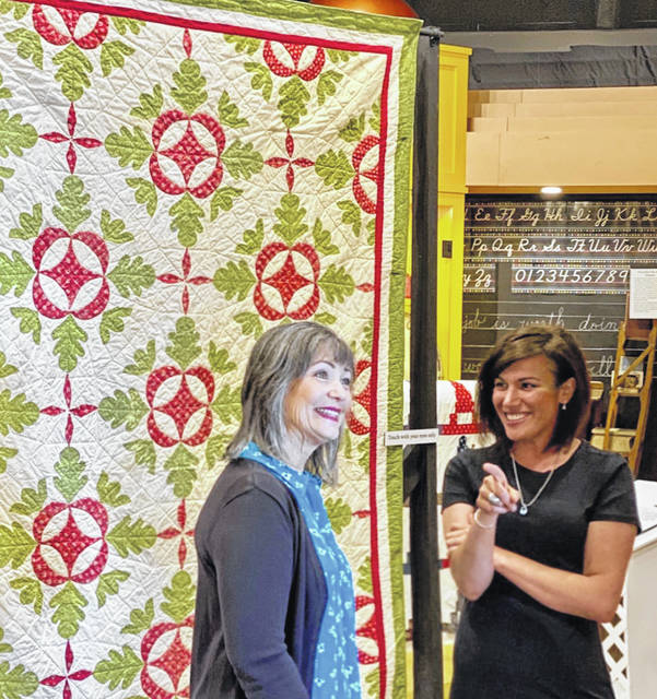 Museum of Fulton County Board Member Jana Rupp, left, enjoys showing Kate Richer the County Quilting Bees exhibit at the Museum of Fulton County.
