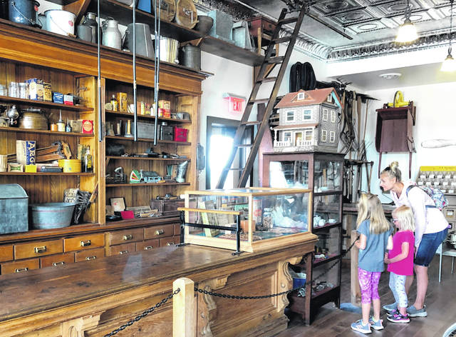 Visitors explore Sauder Village.