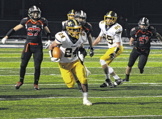 Archbold running back Noah Gomez runs through a hole for positive yards in a playoff game against Liberty Center last season. The Blue Streaks were the preseason pick to take the NWOAL title this season, receiving seven first place votes in a poll taken by the league coaches.