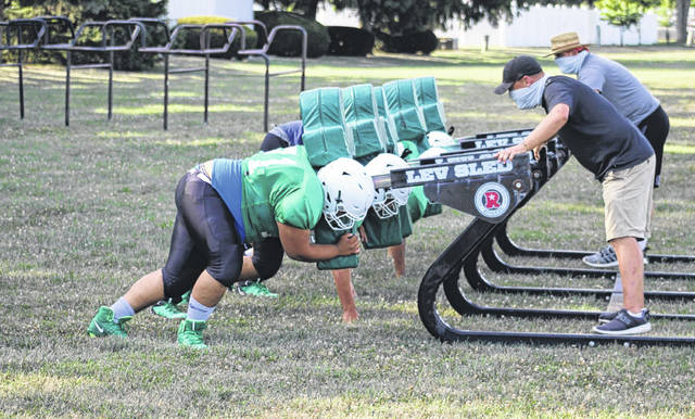 The Delta offensive linemen took turn hitting the sled during Thursday's football practice.