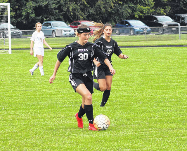 Delta's Annabelle Hughes works the ball upfield in a game versus Toledo Christian last season. Hughes returns for the Panthers after a season in which she was named honorable mention All-NWOAL.