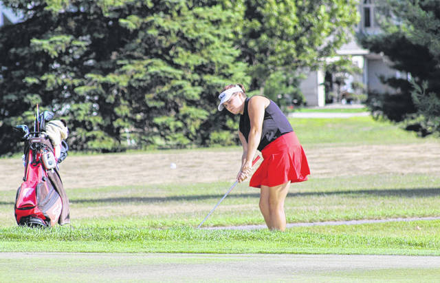 Wauseon's Lexe McQuillin with a chip shot at the third hole at Ironwood Tuesday afternoon. McQuillin led all golfers with a 44 as the Indians defeated Rossford, 200-218.