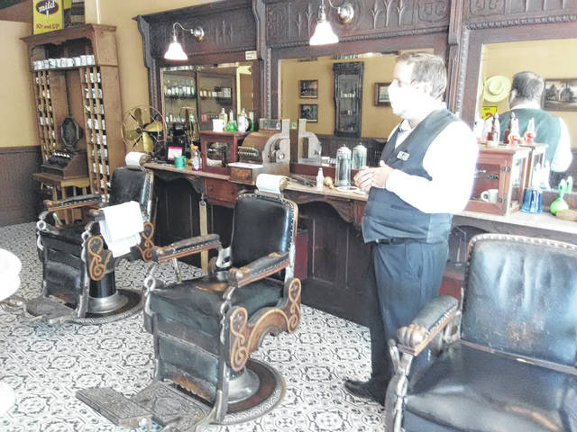 The Okuley Barbershop on 1920s Main Street includes a bathing area.