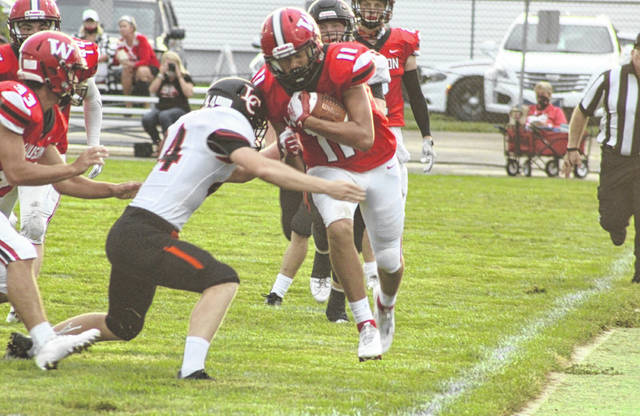 Wauseon's Sam Smith tip-toes the sideline on a kick return Friday in the season opener versus Liberty Center. Smith also had a pair of touchdowns from his receiver position.