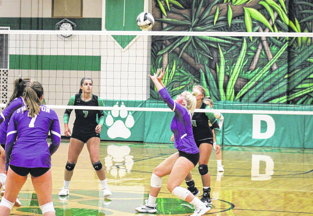 Sofie Taylor of Swanton gets in position to set one up during Thursday's non-league volleyball match at Delta. Despite trailing for much of the first set, the Bulldogs battled back to take that one and the match 25-22, 25-18, 25-22.
