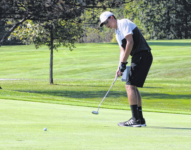 Chase Stickley of Delta with a putt on the third hole green at the 2019 NWOAL Golf Championships. His performance earned him second team All-NWOAL honors.