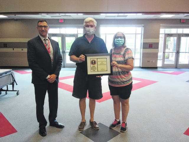 Ace Hardware owners Jeff and Becky Rupp, right, accepted the 2020 Ohio School Boards Association's Business Honor Roll Award from Wauseon schools Superintendent Troy Armstrong, who cited the store's support for the city's public schools.