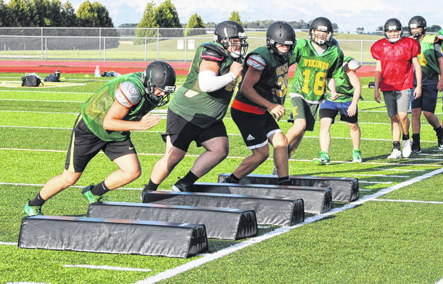 The Vikings conduct some agility drills at the beginning of Tuesday's evening practice. Evergreen is conducting a pair of two-hour practices each day, one in the morning and one in the evening.