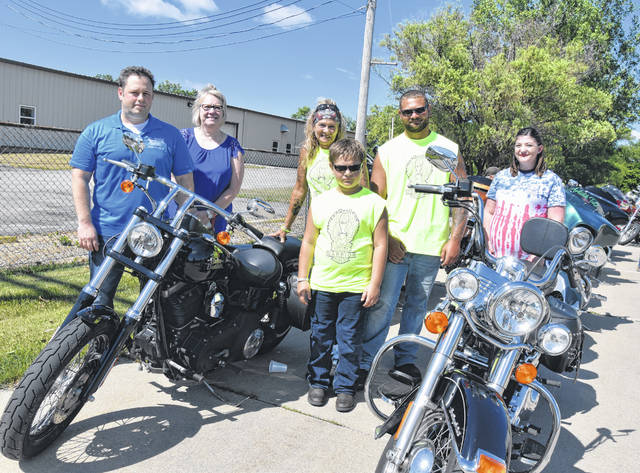 Pictured are representatives of the three organizations that received funding from the ride with three generations of the Deeds family. From left are Rob Spengler, NAMI Four County board member; Jenny Hoeffel, manager of Maumee Valley Guidance Center's supportive services for veterans' families; Julie Deeds with her grandson Bronsyn and son Justin; and Melissa Martin, Operation KAVIC coordinator.