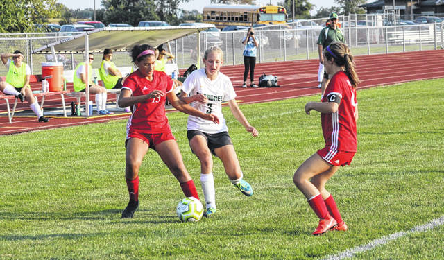 Aariyah Hallett of Wauseon, left, battles for possession with Morgan Kohler of Evergreen (3) during Tuesday's NWOAL match. The Vikings would prevail over the Indians, 3-2.
