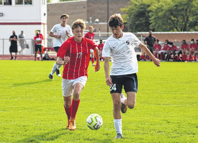Braden Vajen of Wauseon, left, and Karson Rufenacht race to a ball during Tuesday's NWOAL boys soccer match at Wauseon. The Indians bested the Blue Streaks by a 5-1 final.