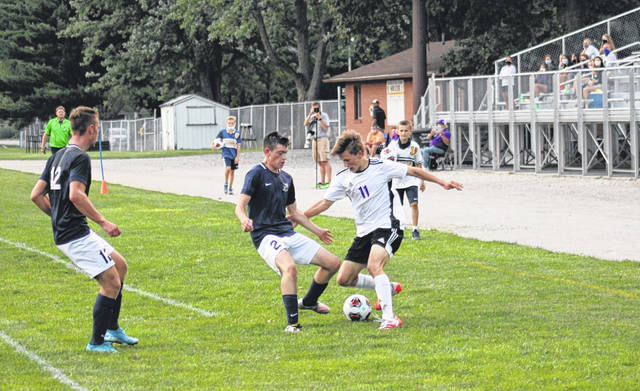 Hayden Callicotte of Swanton, right, handles the ball in the Archbold zone with Kaden Rufenacht guarding him closely. The Blue Streaks pulled away from Swanton in the second half for a 5-3 win Thursday in NWOAL play.