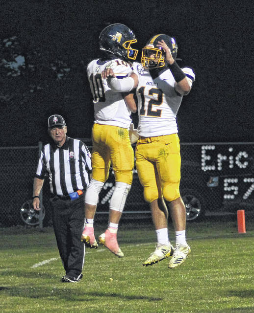 D.J. Newman, left, and Jayden Schulze of Archbold celebrate a Newman touchdown on Friday.