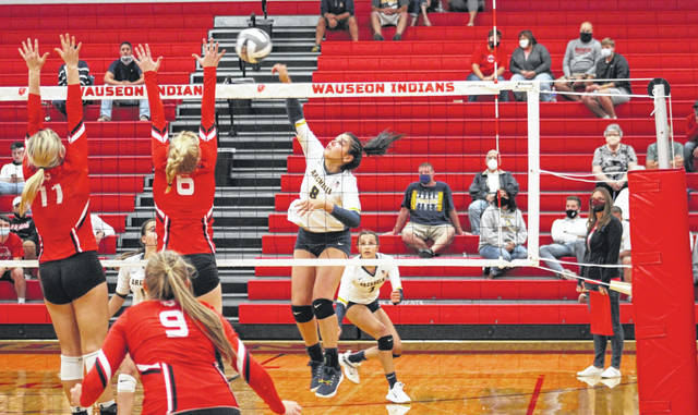Archbold's Hadley Galvan fires one over the net from the left side during Thursday's NWOAL volleyball match at Wauseon. Galvan helped the Blue Streaks earn a 21-25, 25-12, 25-16, 27-25 win over the Indians.