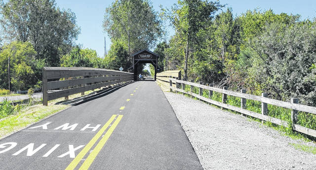 Bicyclists stopped Sunday on the new paved Wabash Cannonball trail at the Fraker Mill Bridge south of the Delta.