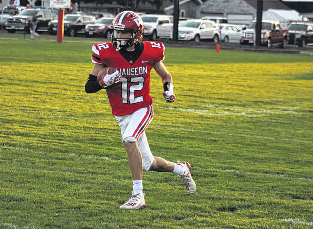 Wauseon's Jonas Tester races up field for a first down catch in the first half of Friday's game against Delta. The Indians ended up shutting out the Panthers by a 35-0 final.