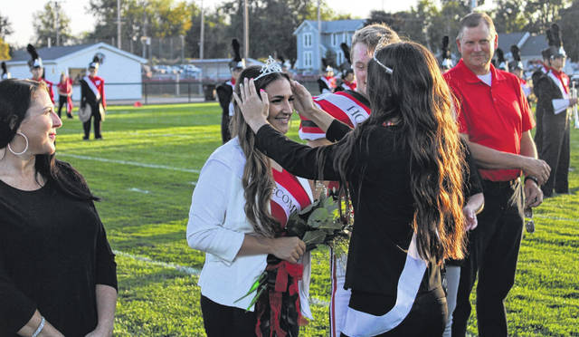 Wauseon's 2020 Homecoming Queen is Victoria Rios. She is seen here receiving her crown from 2019 Queen Paige Smith at a ceremony prior to Friday night's football game with Delta.