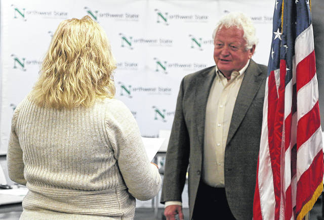 Ron Ernsberger was sworn in Aug. 28 by Northwest State Community College CFO Jennifer Thome as the college's new Board of Trustees member.
