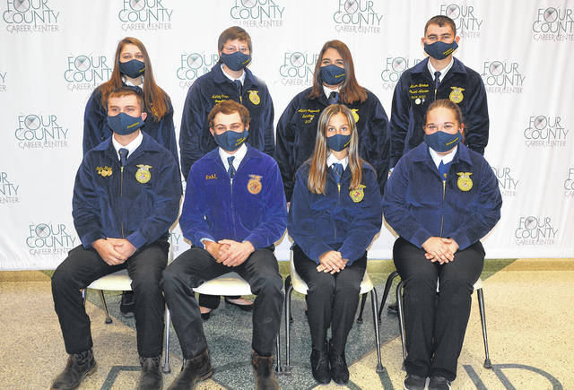 The Four County Career Center FFA chapter in Archbold includes over 130 Agriculture/Diesel Mechanics, Diesel Mechanics, Floral Design, Landscape and Greenhouse Technologies, Powersports, and Veterinarian Assistant students. These students work on chapter projects, compete in district, state, and national FFA leadership and skill competitions, and sponsor student assemblies throughout the school year. Officers of the 2020-21 Four County Career Center FFA chapter include - front, from left - Kolby Stark, Edgerton, president; Luke Pahl, Ayersville, vice president; Natalee Rose, Archbold, secretary; Elizabeth Frost, Hicksville, treasurer - back, from left - Adelei Wachtman, Fairview, chaplain; Ashley Creps of Delta, sentinel; Alexis Miller-Gutierrez, Archbold, reporter; Mason Herman, Edgerton, student advisor. Advisors include Jason Elston, Agriculture/Diesel Mechanics; Florence Luzny, Floral Design; Eric Hite, Landscape and Greenhouse Technologies; Denton Blue, Diesel Mechanics; Larry Soles, Powersports; and Stephanie Pippin, Veterinarian Assistant.