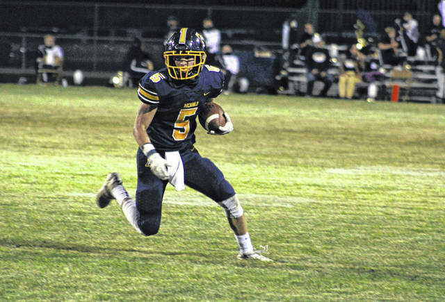Brandon Taylor of Archbold with a reception in a game against Delta this season. The Blue Streaks open the playoffs by hosting Gibsonburg Saturday night.