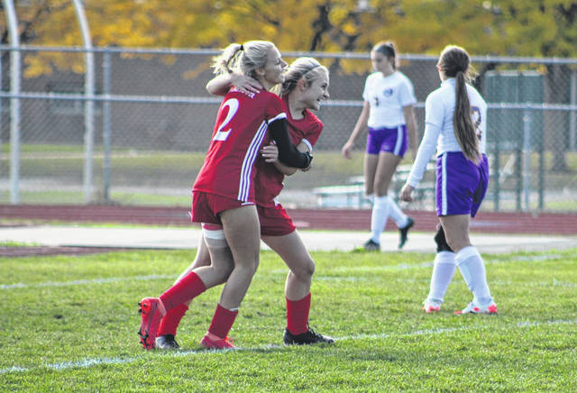 Kya Foote of Wauseon, left, celebrates with Emily Parker after the senior's second of consecutive goals in the second half of a Division II girls soccer sectional final versus Maumee Saturday afternoon. The Indians held on for a 3-2 win over the Panthers.