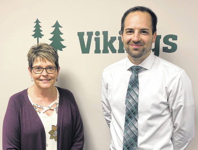 Brian Carroll, right, will replace Denise Leu as treasurer of Evergreen Local Schools.