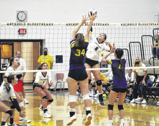 Hadley Galvan of Archbold hits a ball over Tuesday in NWOAL volleyball versus Bryan. The Blue Streaks fell in five sets to the Golden Bears as both teams, and Swanton, finish tied for the league title.