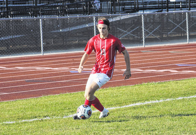 Wauseon's Gavin Gerig gets to a ball near the sideline Thursday in a Division II sectional final versus NWOAL foe Bryan. Gerig tallied a goal in the contest, helping the Indians to a 4-0 shutout of the Golden Bears.