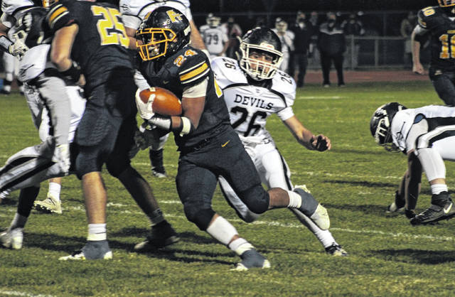 Archbold tailback Noah Gomez sticks his foot in the ground and gets upfield for a 40-yard run Saturday night in a playoff game against Carey. Gomez finished the contest with 106 yards rushing and two touchdowns.