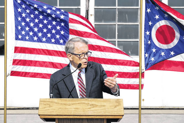 Ohio Gov. Mike DeWine speaks to members of the media at the Eugene F. Krants Toledo Express Airport Friday morning.