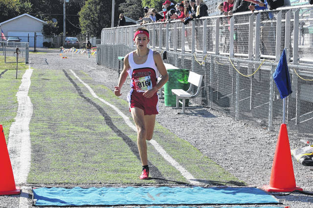 Braden Vernot of Wauseon finishes the boys race at Saturday's NWOAL Cross Country Championships held in Delta. He finished over 21 seconds ahead of the next closest runner to take first overall for the Indians.