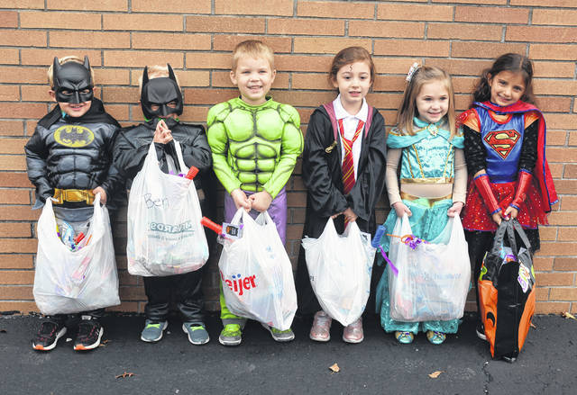 Children from the Four County Career Center Preschool/Childcare went trick-or-treating, gathering candy and goodies while following COVID-19 safety standards for Halloween. Pictured are, from left, Owen Nofziger of Wauseon, Benjamin Norden of Napoleon), Rollie Bostater of Delta, Josephine Berteau of Bryan, Molly Rohda of Liberty Center, and Camila Zetter of Whitehouse.