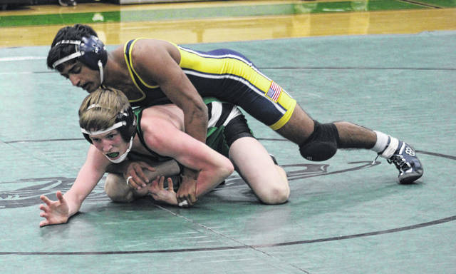 Archbold's Andrew Francis, top, controls Carson Chiesa of Delta in a match last season. Francis returns as a previous state qualifier for the Blue Streaks in 2020-21.