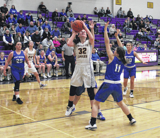 Trista Fruchey of Fayette makes a basket in a sectional tournament game versus Antwerp a season ago. She is a primary player back for the Eagles in 2020-21.