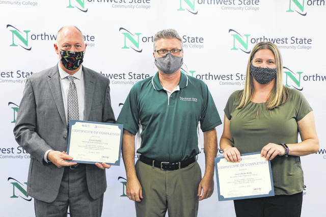 NSCC Board of Trustees Chair Joel Miller, center, congratulates Dr. Dan Burklo and Cassie Rickenberg for completing their Ohio Leadership Academy training through the OACC.