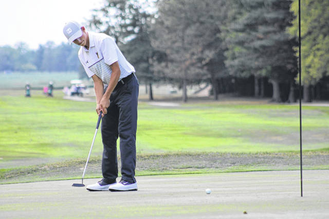 Max Leppelmeier of Pettisville putts a ball in a match at Ironwood from earlier this season. He was tabbed as the player of the year in Division III for the Northwest District when all-district golf teams were announced last week.