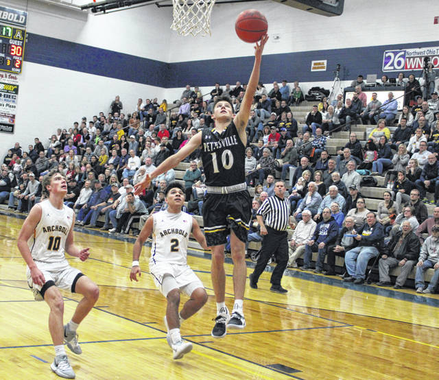 Pettisville's Max Leppelmeier with a steal and score in a game at Archbold last season. Leppelmeier returns for the Blackbirds after receiving second team All-BBC and District 7 honors in 2019-20.
