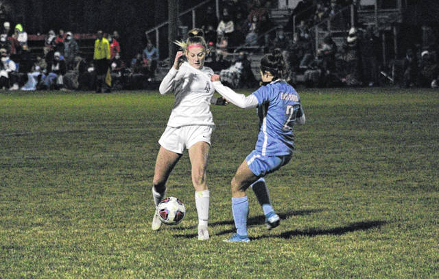 Leah McQuade of Archbold maintains possession of the ball while Shelby Getz of Eastwood defends during a Division III girls soccer regional semifinal Tuesday. McQuade scored a goal with 8:45 left in regulation to send the game to overtime, but ultimately the Eagles prevailed in the extra session 2-1.