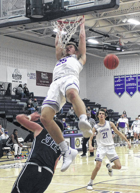 Swanton's Cole Mitchey is fouled as he attempts a dunk against Lake on Friday.