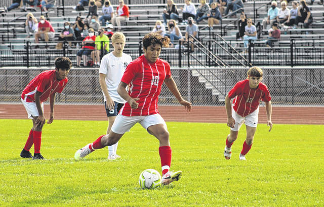 Benicio Torres of Wauseon hits a penalty kick in a game against Archbold this season. He was selected first team All-NWOAL for the Indians.