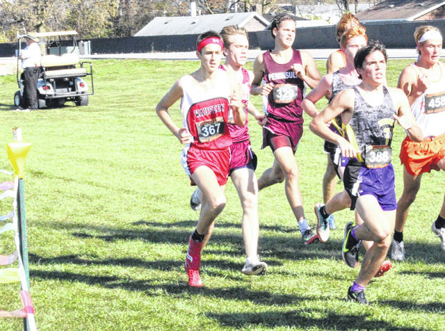 Wauseon's Braden Vernot runs in a small pack during the cross country state championships at Fortress Obetz on Saturday. Vernot would finish ninth overall to earn All-Ohio honors in Division II.