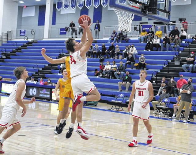 Wauseon's Jude Armstrong goes strong to the hoop for a layup in the second quarter of Tuesday night's championship of the Grube Family Holiday Classic at Defiance. The Indians defeated Bryan 45-33 for the title.