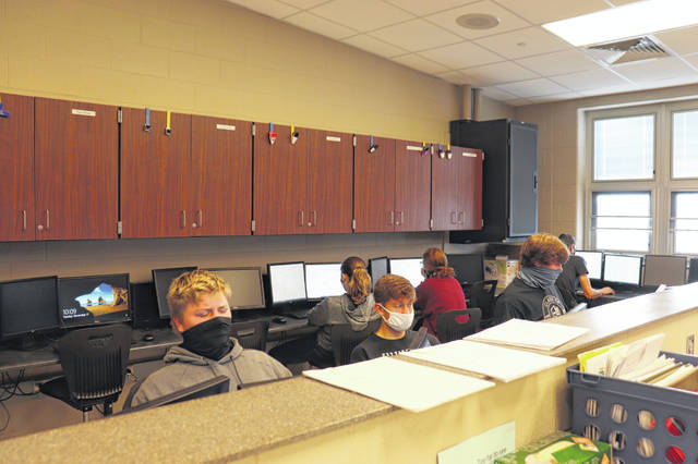 From left, Pettisville FFA members Colton Wood, Blake Eyer, and Andrew Hulbert complete the online test for the Wildlife CDE competition held Nov. 17.