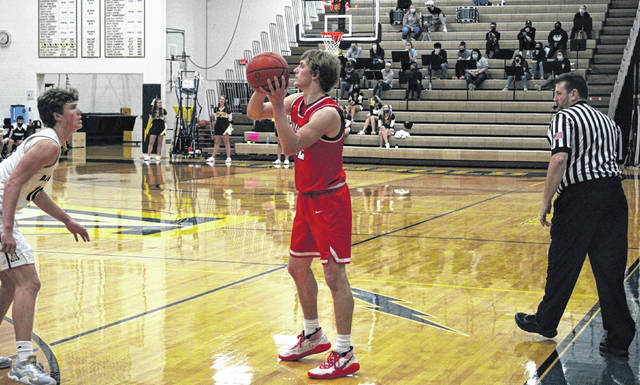 Connar Penrod of Wauseon looks for a teammate to pass to as Archbold's DJ Newman guards from a distance. Penrod finished with 17 points on the night as the Indians defeated the Blue Streaks 40-34 Thursday in non-league action.