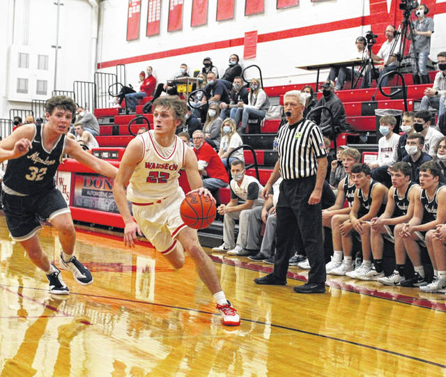 Wauseon's Connar Penrod drives in from the wing during the game versus Napoleon Saturday night. Penrod led all scorers with 31 points as the Indians defeated the Wildcats 54-43.