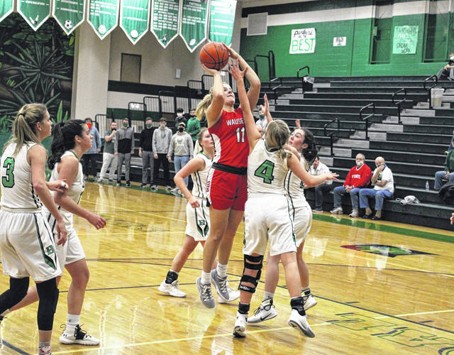 Chelsie Raabe of Wauseon puts up a shot with a hand in her face during Thursday's game at Delta. She scored 10 points as the Indians held on for a 37-35 victory.