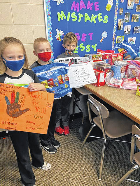 Students at Wauseon Elementary School prepare to send letters of appreciation and gifts of snacks to essential workers at several local health care facilities.