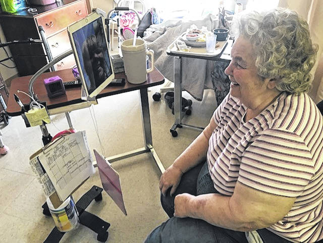 Marilyn Gryca FaceTimes with family at Swanton Valley Rehabilitation and Healthcare Center. Nearly all visitors had been banned from nursing homes due to COVID-19.